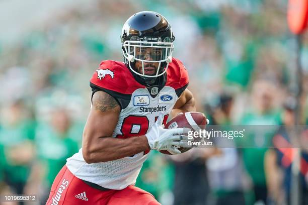 Juwan Brescacin of the Calgary Stampeders on his way to a touchdown in the game between the Calgary Stampeders and Saskatchewan Roughriders at Mosaic...
