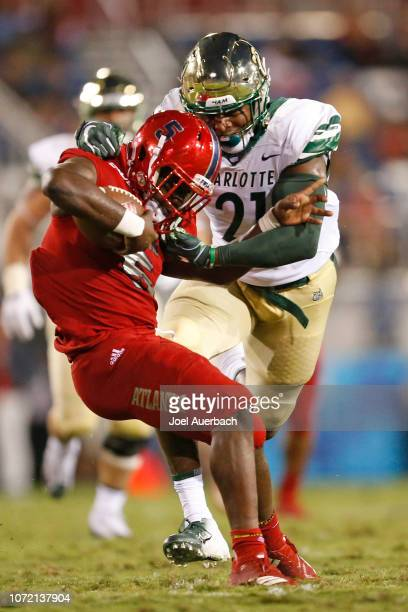 Juwan Foggie of the Charlotte 49ers tackles Devin Singletary of the Florida Atlantic Owls as he runs with the ball on November 24 2018 at FAU Stadium...