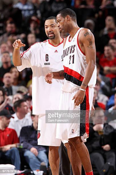 Juwan Howard and Marcus Camby of the Portland Trail Blazers talk on the court during the game against the Boston Celtics at The Rose Garden on...