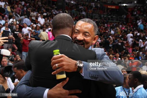 Juwan Howard congratulates Chris Bosh during his jersey retirement ceremony at halftime of the game between the Orlando Magic and the Miami Heat on...