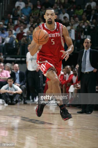 Juwan Howard of the Houston Rockets brings the ball upcourt against the New Orleans/Oklahoma City Hornets during the game at the New Orleans Arena on...