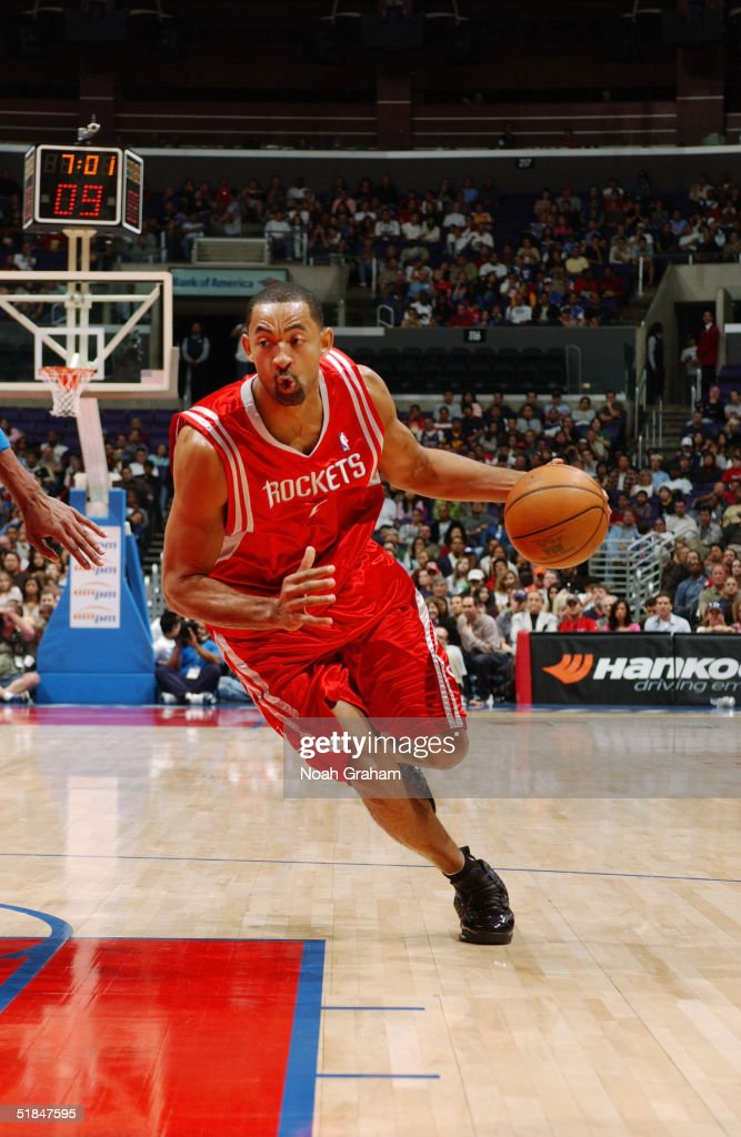 Juwan Howard #5 of the Houston Rockets drives toward the basket during the game against the Los Angeles Clippers at Staples Center on November 20, 2004 in Los Angeles, California. The Rockets won in overtime 91-86.