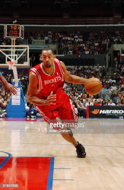 Juwan Howard of the Houston Rockets drives toward the basket during the game against the Los Angeles Clippers at Staples Center on November 20 2004...