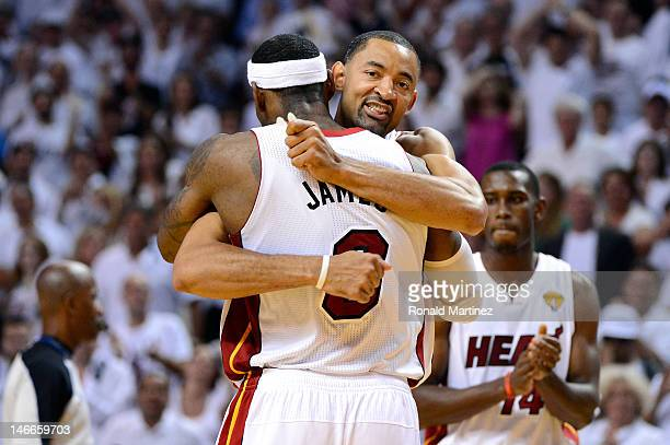 Juwan Howard of the Miami Heat celebrates with LeBron James late in the fourth quarter against the Oklahoma City Thunder in Game Five of the 2012 NBA...