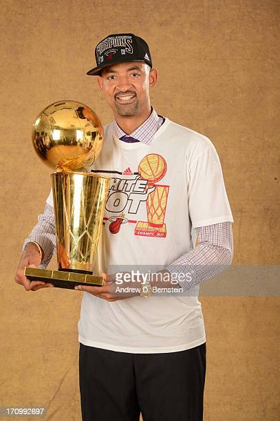 Juwan Howard of the Miami Heat poses for a portrait with the Larry O'Brien Trophy after defeating the San Antonio Spurs in Game Seven of the 2013 NBA...