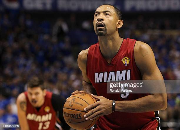 Juwan Howard of the Miami Heat shoots a free throw while taking on the Dallas Mavericks in Game Three of the 2011 NBA Finals at American Airlines...