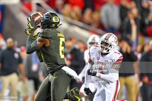 Juwan Johnson of the Oregon Ducks catches a 45 yard pass over Jaylon Johnson of the Utah Utes early in the second quarter during the Pac12...