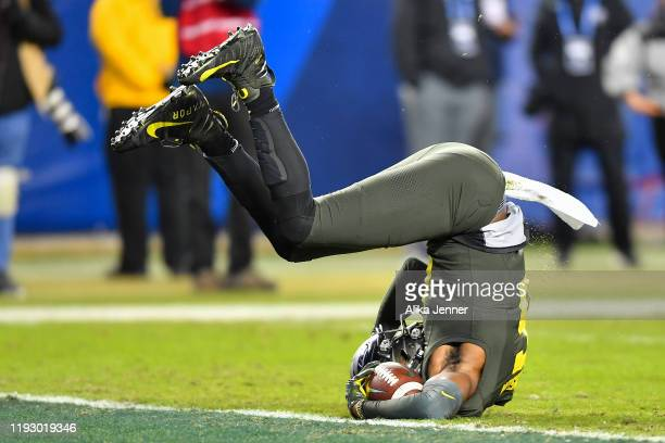 Juwan Johnson of the Oregon Ducks flips after being tackled by Jaylon Johnson of the Utah Utes during the Pac12 Championship football game at Levi's...
