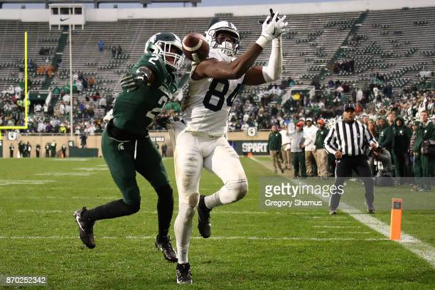 Juwan Johnson of the Penn State Nittany Lions can't make a second half catch next to Justin Layne of the Michigan State Spartans at Spartan Stadium...