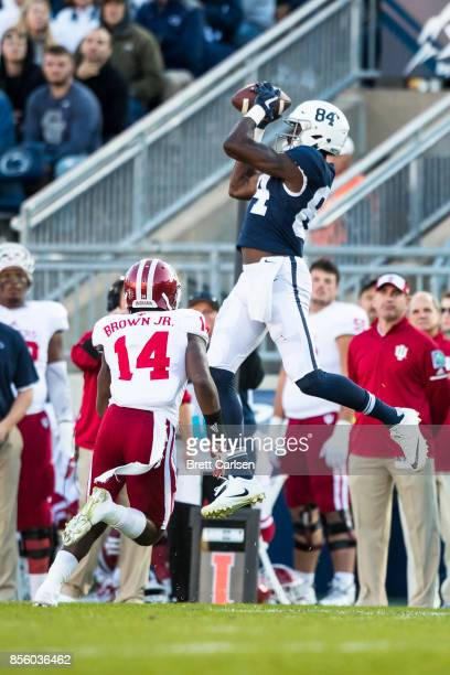 Juwan Johnson of the Penn State Nittany Lions goes up for a first down reception over the head of Andre Brown Jr #14 of the Indiana Hoosiers during...