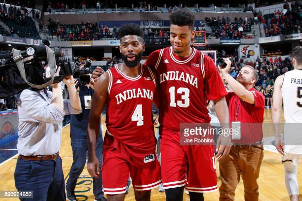 Juwan Morgan and Robert Johnson of the Indiana Hoosiers celebrate after the game against the Notre Dame Fighting Irish in the Crossroads Classic at...