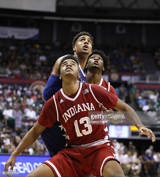 Juwan Morgan of the Indiana Hoosiers boxes out Landen Lucas of the Kansas Jayhawks during the first half of the second game of the Armed Forces...
