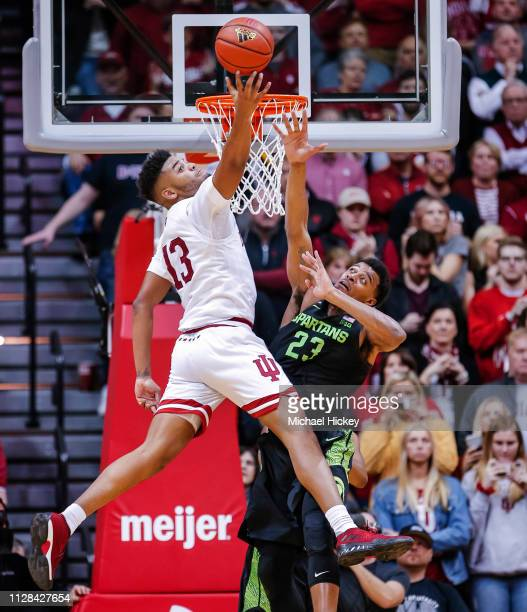 Juwan Morgan of the Indiana Hoosiers reaches back for a rebound during the game against Xavier Tillman of the Michigan State Spartans at Assembly...