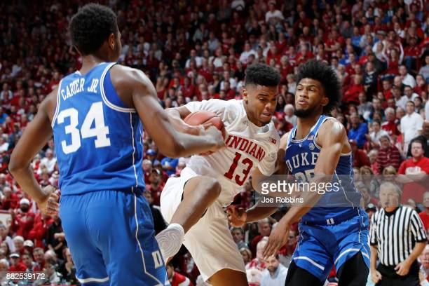 Juwan Morgan of the Indiana Hoosiers rebounds against Marvin Bagley III and Wendell Carter Jr #34 of the Duke Blue Devils in the first half of a game...