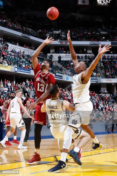 Juwan Morgan of the Indiana Hoosiers scores in the lane in overtime against Bonzie Colson and Matt Farrell of the Notre Dame Fighting Irish during...