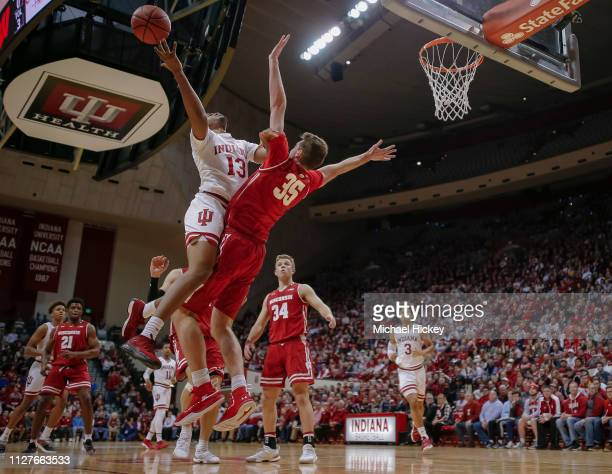 Juwan Morgan of the Indiana Hoosiers shoots the ball against Nate Reuvers of the Wisconsin Badgers at Assembly Hall on February 26 2019 in...
