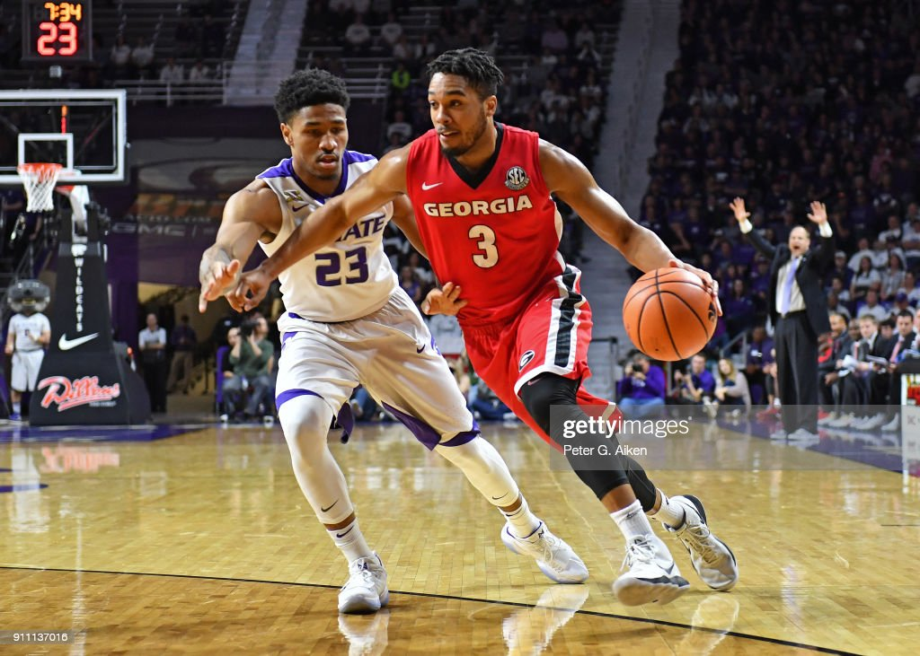 Juwan Parker #3 of the Georgia Bulldogs drives with the ball against Amaad Wainright #23 of the Kansas State Wildcats during the first half on January 27, 2018 at Bramlage Coliseum in Manhattan, Kansas.