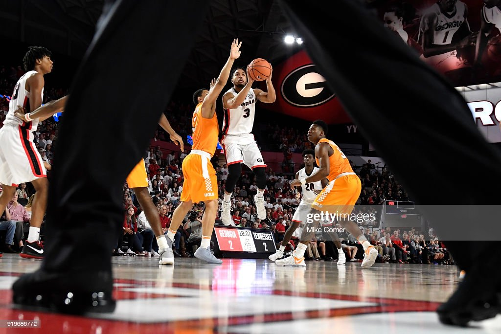 Juwan Parker #3 of the Georgia Bulldogs shoots a jump shot past Grant Williams #2 of the Tennessee Volunteers during the basketball game at Stegeman Coliseum on February 17, 2018 in Athens, Georgia.