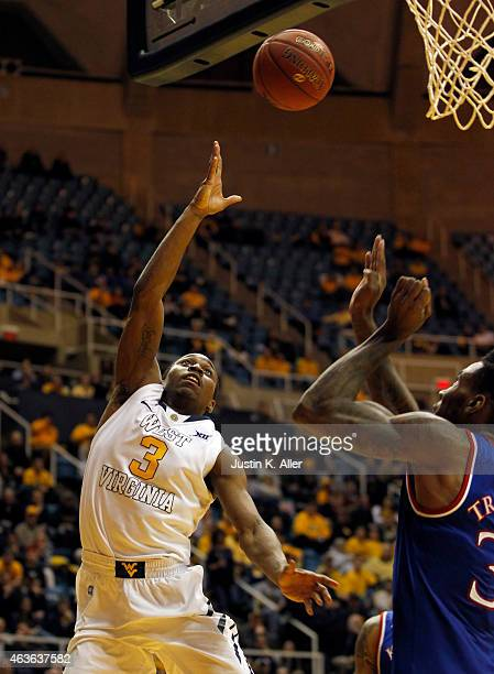 Juwan Staten of the West Virginia Mountaineers scores against the Kansas Jayhawks during the game at the WVU Coliseum on February 16, 2015 in...