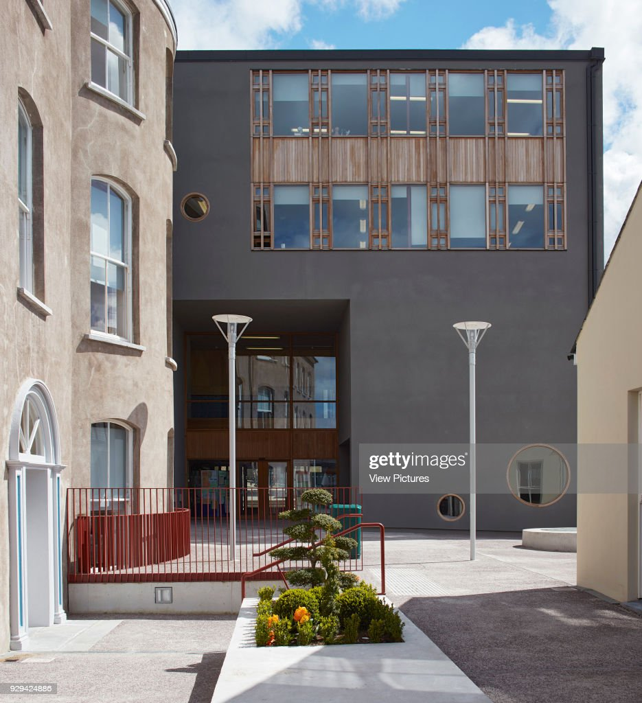 juxtaposition of existing historic facade and new building in main schoolyard st angelas college cork