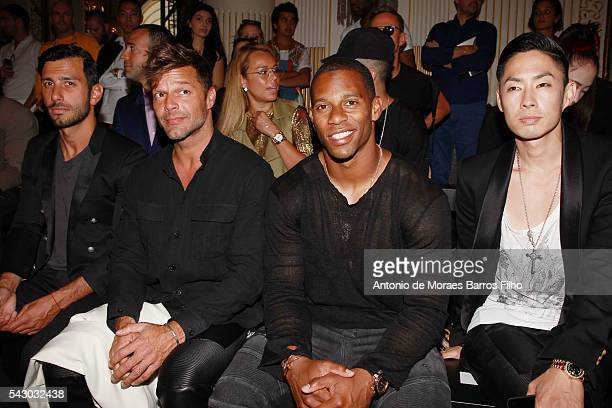 Jwan Yosef Ricky Martin Victor Cruz attend the Balmain Menswear Spring/Summer 2017 show as part of Paris Fashion Week on June 25 2016 in Paris France