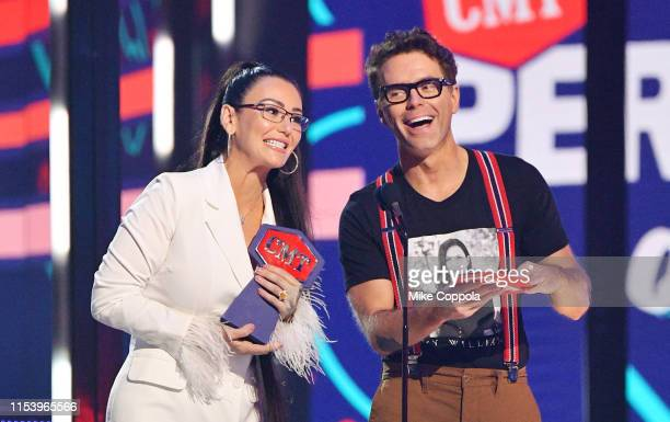JWoww and Bobby Bones present an award at the 2019 CMT Music Awards at Bridgestone Arena on June 05, 2019 in Nashville, Tennessee.