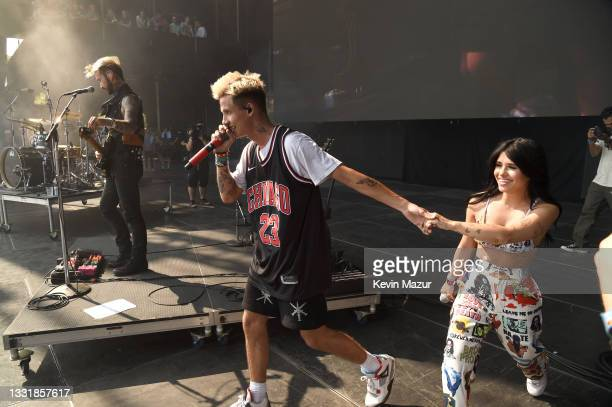 Jxdn brings Nessa Barrett on stage during Lollapalooza 2021 at Grant Park on August 01, 2021 in Chicago, Illinois.