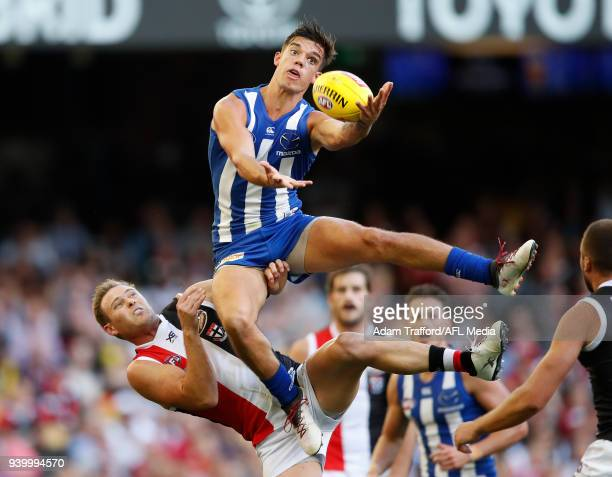 Jy Simpkin of the Kangaroos flies for the ball over David Armitage of the Saints during the 2018 AFL round 02 Good Friday Kick for the Kids match...