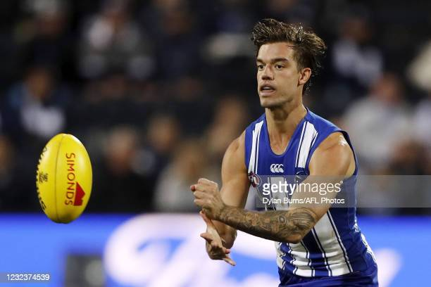 Jy Simpkin of the Kangaroos handpasses the ball during the 2021 AFL Round 05 match between the Geelong Cats and the North Melbourne Kangaroos at...