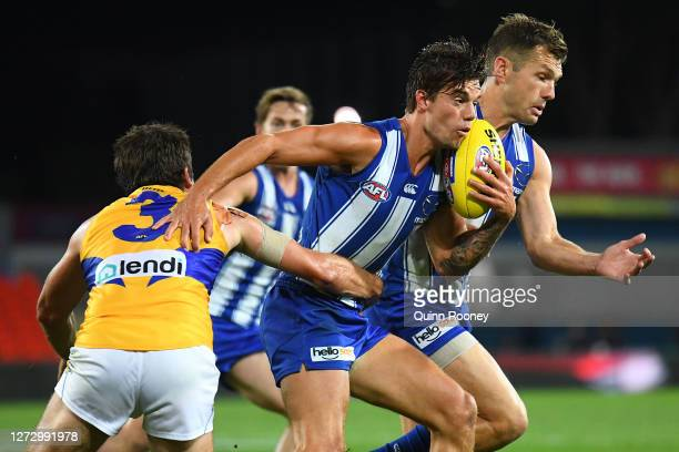 Jy Simpkin of the Kangaroos is tackled by Andrew Gaff of the Eagles during the round 18 AFL match between the North Melbourne Kangaroos and the West...