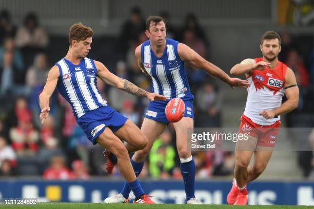 Jy Simpkin of the kangaroos kicks the ball during the 2020 Marsh Community Series AFL match between the North Melbourne Kangaroos and the Sydney...