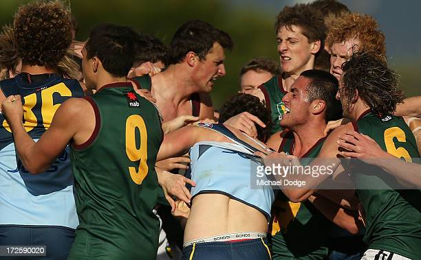 Jydon Neagle of NSW/ACT is caught in a headlock by Phil Bellchambers of Tasmania during a melee during the round five AFL Under 18s Championship...