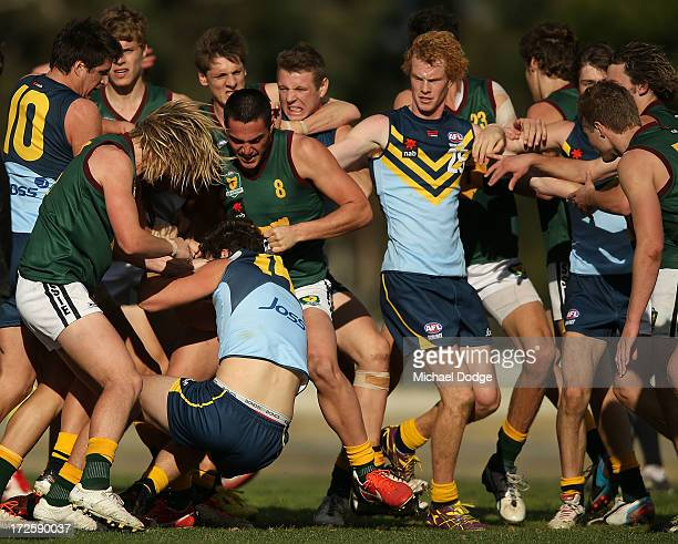 Jydon Neagle of NSW/ACT is wrestled to the ground by Eli Templeton and Phil Bellchambers of Tasmania during a melee during the round five AFL Under...