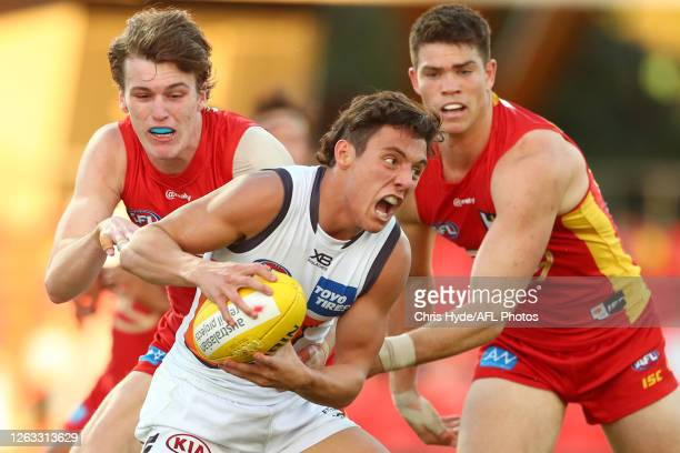 Jye Caldwell of the Giants is tackled during the round nine AFL match between Gold Coast Suns and the Greater Western Sydney Giants at Metricon...