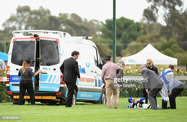 Jye McNeil lays on a stretcher after coming off Preemptive in Race 4 during Melbourne racing at Bendigo Racecourse on March 19 2016 in Bendigo...