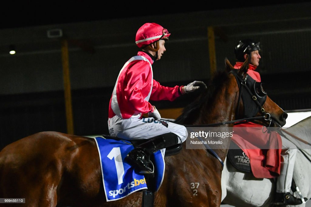 Jye McNeil returns to the mounting yard aboard Believing after winning the Sportsbet Racing Form BM64 Handicap at Racing.com Park Synthetic Racecourse on May 17, 2018 in Pakenham, Australia.