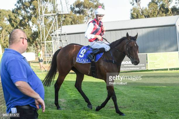 Jye McNeil returns to the mounting yard on Fabrication after winning the 1PRINT FM BM58 Handicap at Echuca Racecourse on April 23 2018 in Echuca...