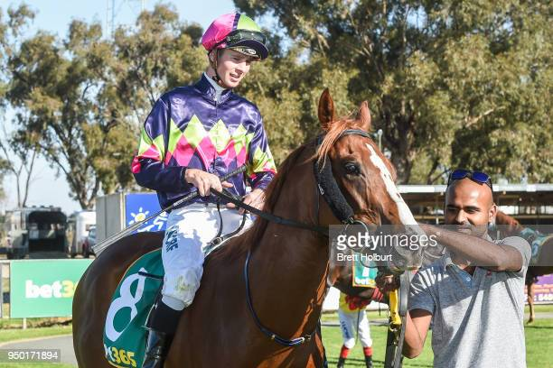 Jye McNeil returns to the mounting yard on Interesting after winning the Quest Echuca Maiden Plate at Echuca Racecourse on April 23 2018 in Echuca...