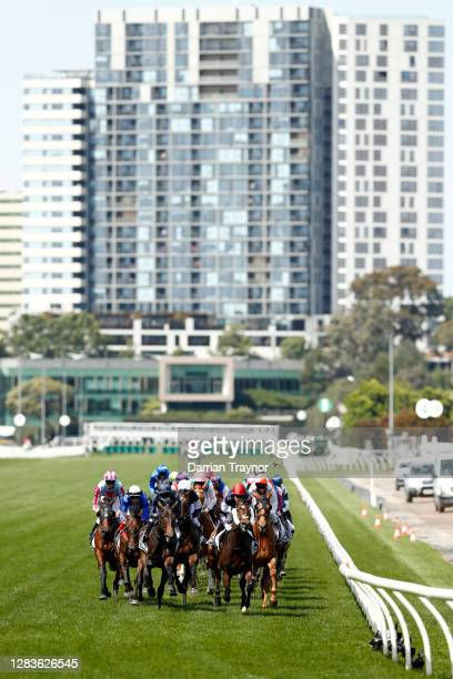 Jye McNiel on board Twilight Payment leads the field past the post for the first time in race 7 the Lexus Melbourne Cup during 2020 Lexus Melbourne...