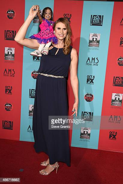 Jyoti Amge and Erika Ervin arrives at the American Horror Story Freak Show Los Angeles Premiere at TCL Chinese Theatre IMAX on October 5 2014 in...