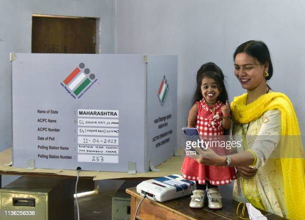 TOPSHOT Jyoti Amge Indian world's smallest woman casts her vote for the first phase of India's general election at a polling station in Nagpur on...