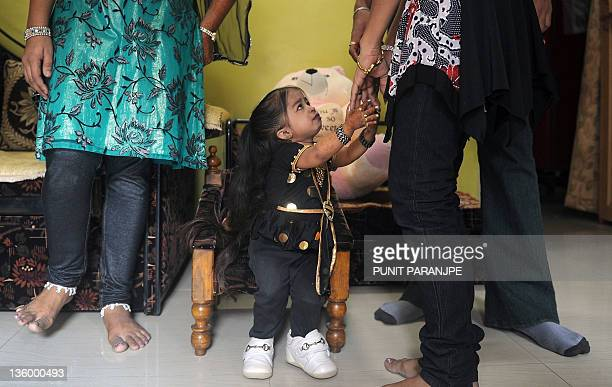 Jyoti Amge interacts with her sisters at her residence in Nagpur on December 16 2011 Amge is currently recognized as the shortest living teenager...