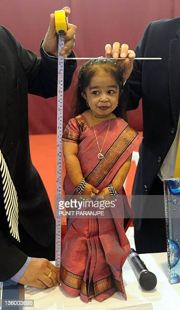 Jyoti Amge is measured for her height during a news conference in Nagpur on December 16 2011 Amge was officially announced by the Guinness World...