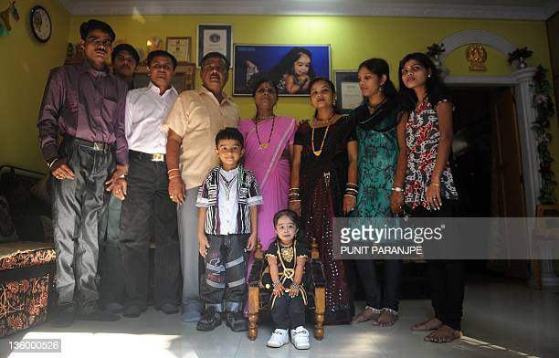 Jyoti Amge poses with family at her residence in Nagpur on December 16 2011 Amge is currently recognized as the shortest living teenager measured as...