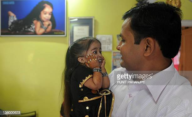Jyoti Amge reacts as she receives birthday greetings from a relative at her residence in Nagpur on December 16 2011 Amge is currently recognized as...