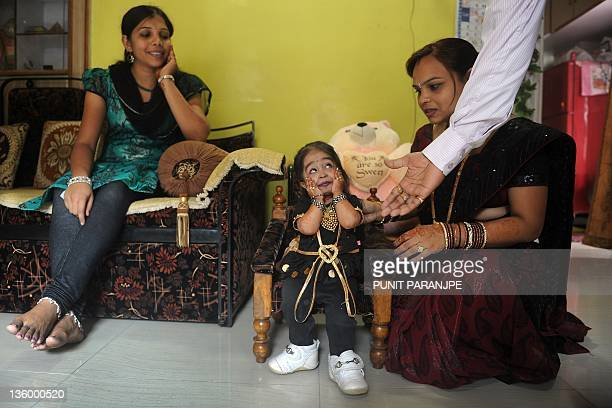Jyoti Amge reacts as she receives birthday greetings from relatives at her residence in Nagpur on December 16 2011 Amge is currently recognized as...