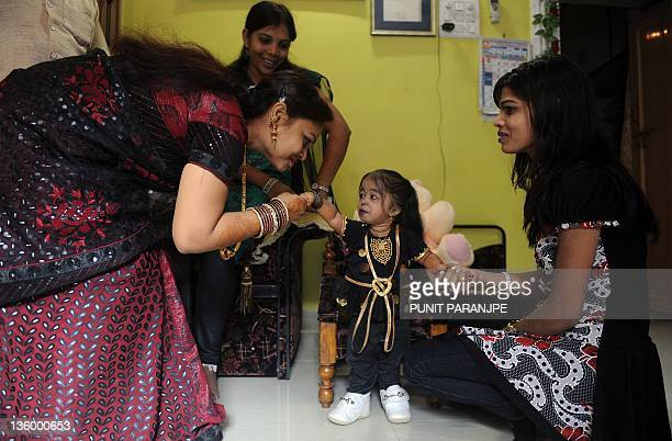Jyoti Amge receives birthday greetings from relatives at her residence in Nagpur on December 16 2011 Amge is currently recognized as the shortest...