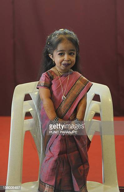 Jyoti Amge stands on a chair during a news conference in Nagpur on December 16 2011 Amge was officially announced by the Guinness World Records on...