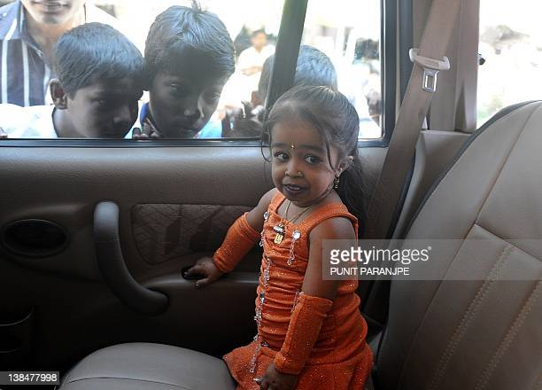 Jyoti Amge the world's shortest woman living sits in a car while campaigning for a local rightwing political party in the runup to the forthcoming...