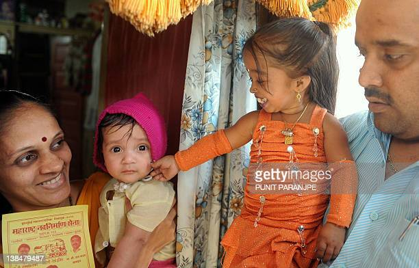 Jyoti Amge world's shortest woman living interacts with local residents while campaigning for a local political party in Mumbai on February 7 2012...